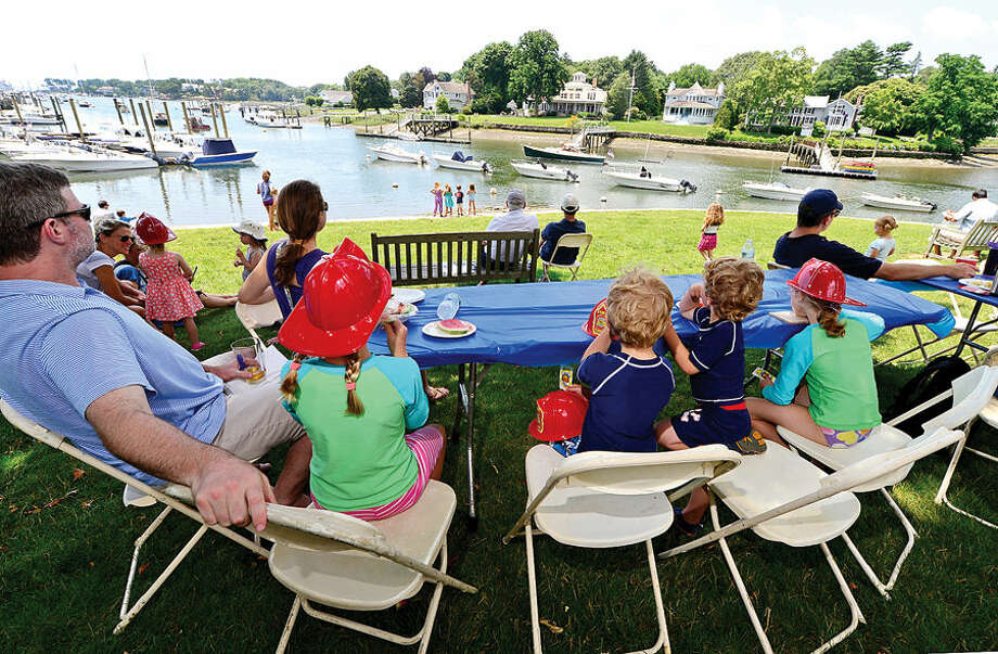Hour photo / Erik Trautmann The Quill family, Patrick, Diana, Katie , Patrick, Denis and Carolyn, takes in the view of the Five Mile River during the 45th annual Rowayton Civic Association River Ramble! at Pinkney Park Saturday.