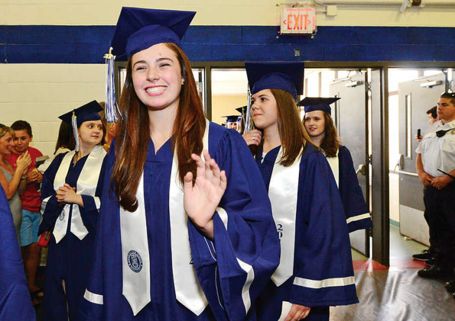 Hour photo / Erik Trautmann Staples High school senior celebrate the graduation of the Class of 2014 during commencement exercises in Westport Friday afternoon.