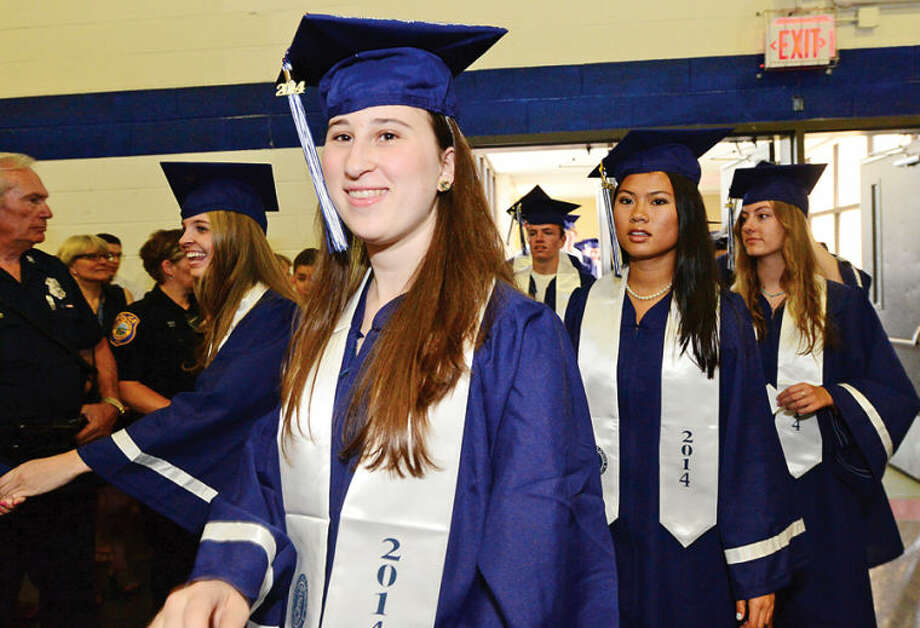 Hour photo / Erik Trautmann Staples High school seniors including Liana Sonenclar celebrate the graduation of the Class of 2014 during commencement exercises in Westport Friday afternoon.