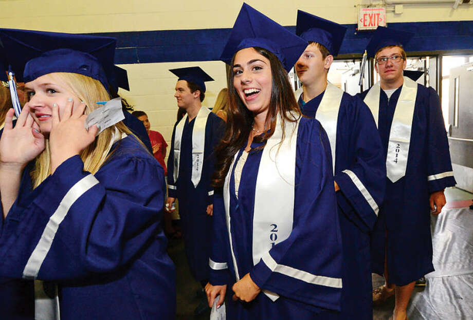 Hour photo / Erik Trautmann Staples High school seniors including Katelyn Farnen celebrate the graduation of the Class of 2014 during commencement exercises in Westport Friday afternoon.