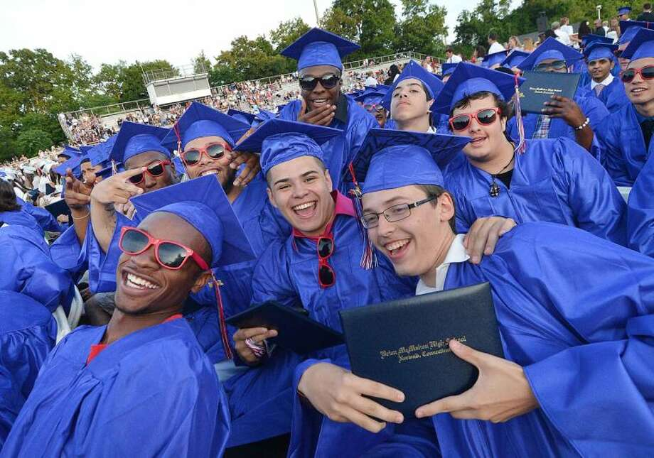 Hour Photo/Alex von Kleydorff Diplomas in hand for this group of the Brien McMahon Class of 2014