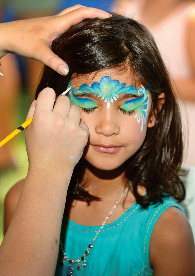 Hour photo / Erik Trautmann Lekha Wood, 6, get her face painted during the 45th annual Rowayton Civic Association River Ramble! at Pinkney Park Saturday.