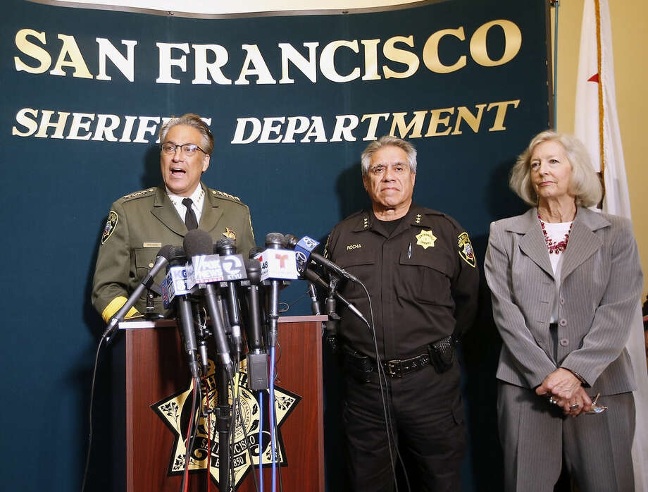 San Francisco Sheriff Ross Mirkarimi, left, Under Sheriff Federico Rocha and legal counsel Freya Horne, right, speak during a news conference, Friday, July 10, 2015, in San Francisco. Mirkarimi provided information regarding the April 2015 release of Juan Francisco Lopez-Sanchez, who is now accused in the shooting death of a woman at a popular tourist site. (AP Photo/Tony Avelar)