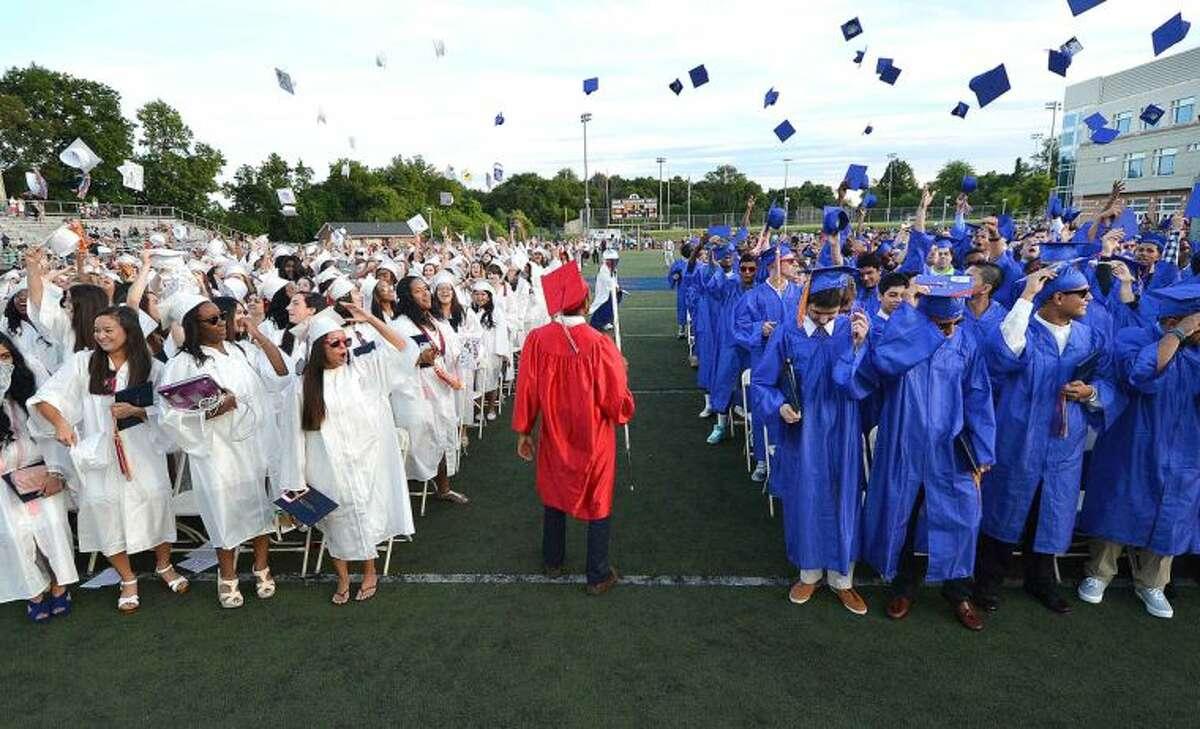 Hour Photo/Alex von Kleydorff Caps in the air for the Brien McMahon Class of 2014