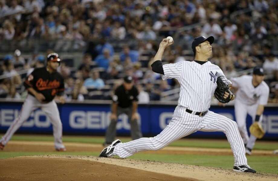 New York Yankees pitcher Hiroki Kuroda (18) delivers against the Baltimore Orioles in the sixth inning of a baseball game, Friday, June 20, 2014, in New York. (AP Photo/Julie Jacobson)