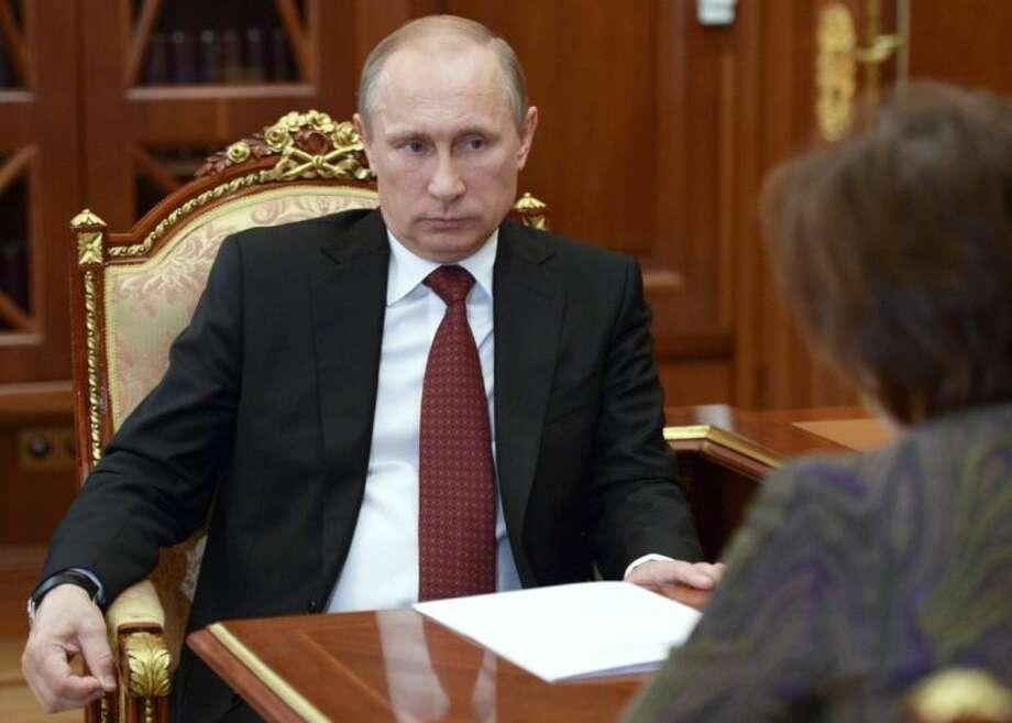 Russian President Vladimir Putin meets with Khanty-Mansiysk Governor Natalya Komarova in the Kremlin in Moscow, Russia, Friday, June 20, 2014. (AP Photo/RIA-Novosti, Alexei Nikolsky, Presidential Press Service)