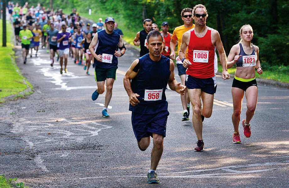 Hour photo / Erik Trautmann Participants set out on a 5 mile race during Lightfoot Running Club The 2015 Norwalk Summer Series Saturday at Cranbury Elemenatry School.