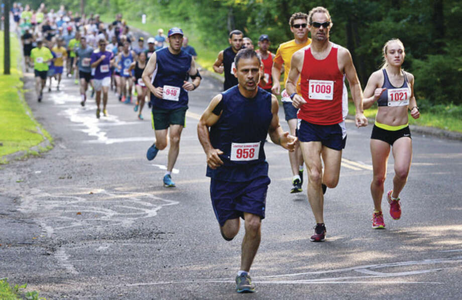 Hour photo/Erik TrautmannParticipants set out on a five-mile race during Lightfoot Running Club road race on Saturday.