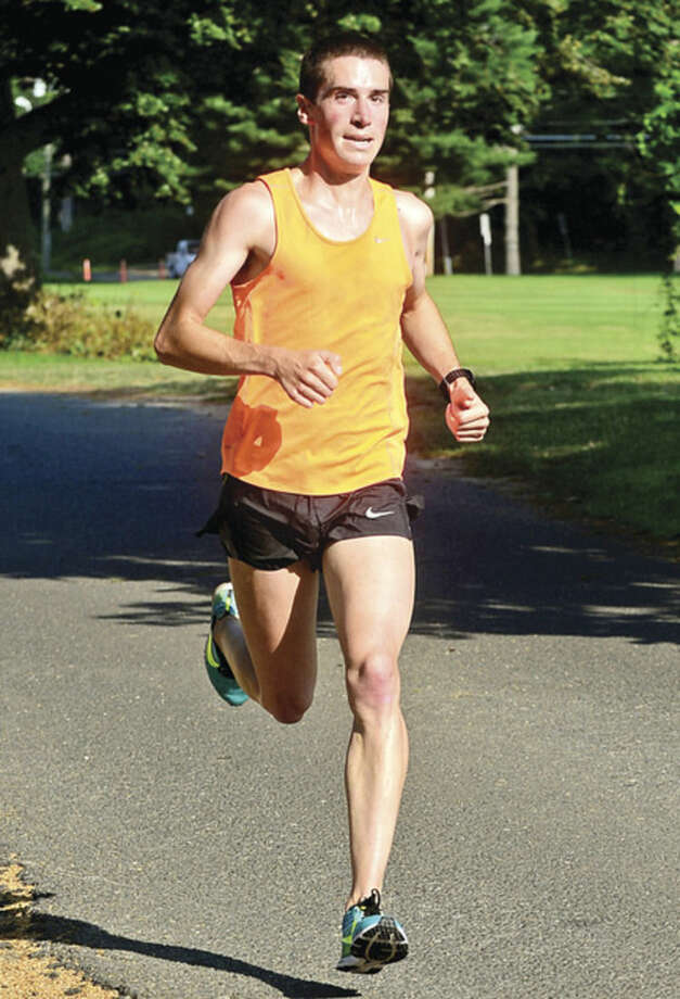 Hour photo / Erik Trautmann Kevin Hoyt finishes first in the 3.1 mile race during the Westport Road Runners Summer Series Saturday at Longshore Park.