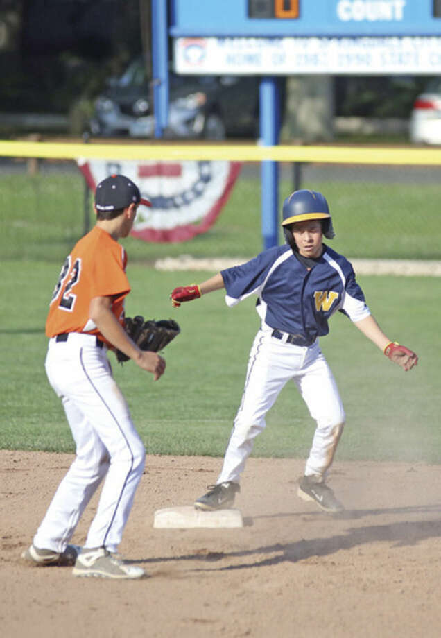 Hour photo/Danielle CallowayWeston's Myles Lehrman, right, steals second base during Friday's District 1 Little League game against Ridgefield at Springdale Field in Stamford. Weston dropped an 11-6 decision to Ridgefield.