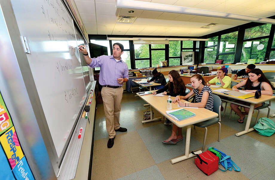 Algebra instructor Eamon Depeter instructs students who are taking classes to get a jump-start on their fall studies Tuesday during the Summer Institute at King Low Heywood Thomas School in Stamford.