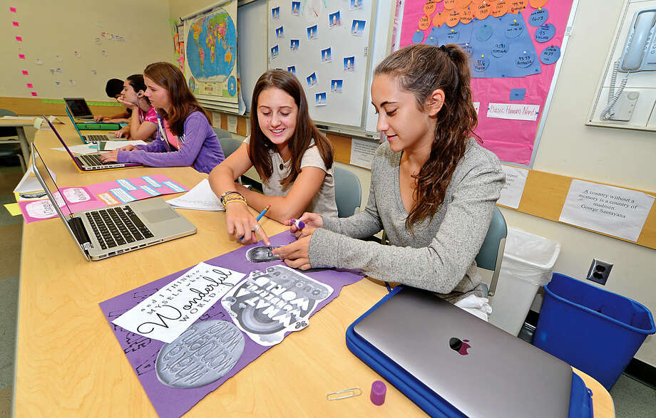 Students Megan Glinka and Carli Levethan are taking classes like global studies to get a jump-start on their fall studies Tuesday during the Summer Institute at King Low Heywood Thomas School in Stamford.