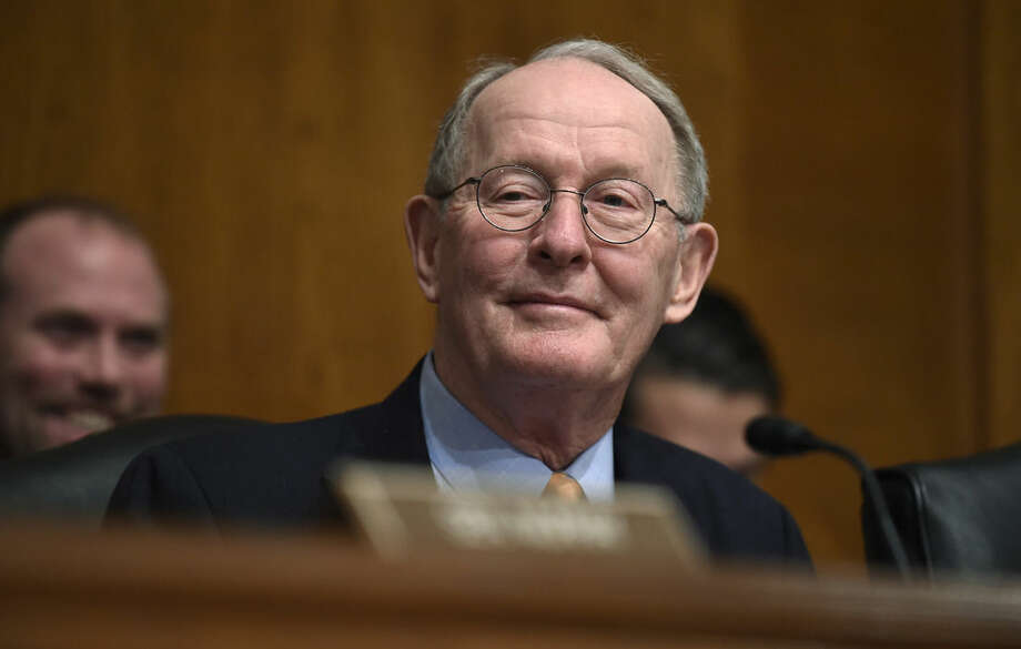 FILE - In this Jan. 21, 2015 file photo, Senate Health, Education, Labor and Pensions Committee Chairman Sen. Lamar Alexander, R-Tenn. listens to testimony on Capitol Hill in Washington. The nation's main education law, long overdue for an overhaul, is headed for a major revision in the Senate. Lawmakers plan to vote July 16 on a bipartisan bill to rewrite the Bush-era No Child Left Behind Act, a day after voting 86-12 to limit additional debate on further changes to the bill and move forward to a vote on final passage. (AP Photo/Susan Walsh, File)