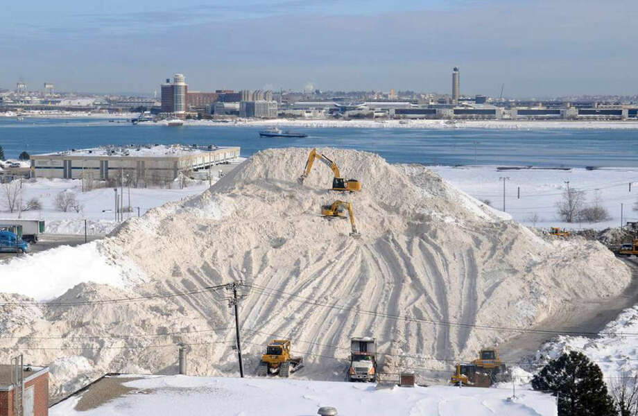 In this Feb. 18, 2015 photo, snow piles up in Boston. Mayor Martin Walsh announced Tuesday, July 14, that Boston's once-massive pile of filthy snow has officially dwindled to nothing. (Jim Walker/Conventures, Inc. via AP)