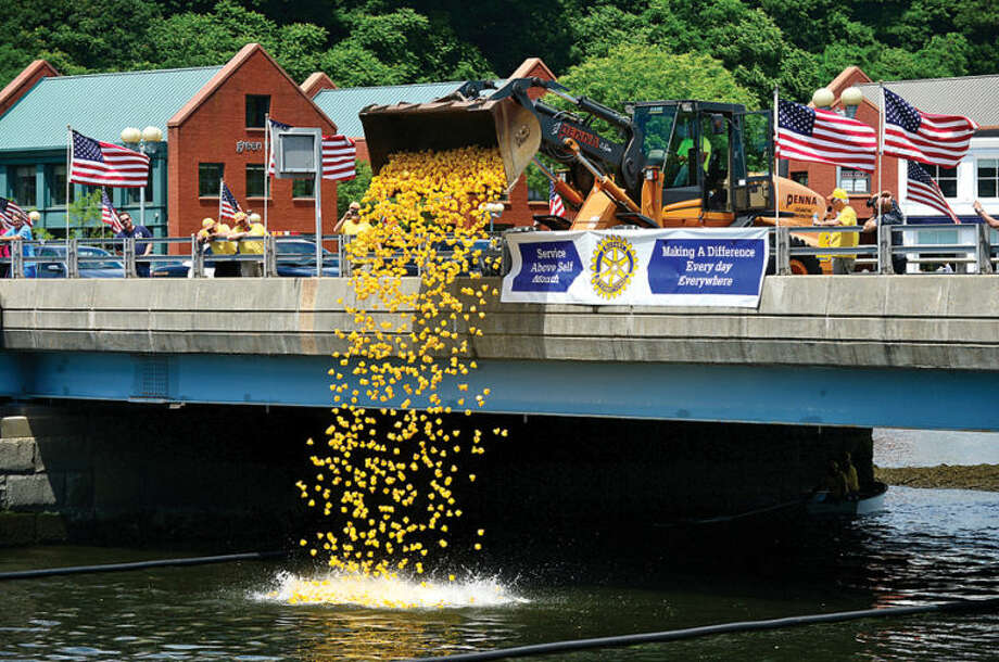 Hour photo / Erik Trautmann Over 2,500 rubber duckies are launched during the Westport Sunrise Rotary's annual Great Duck Race event at the Saugatuck River in downtown Westport Saturday.