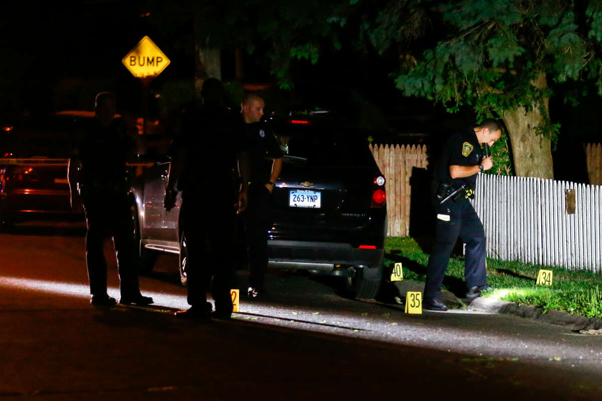 Hour photo/Chris Palermo Norwalk Police Officers investigate the scene at Glaser Street where there was a reported shots fired incident Wednesday night.