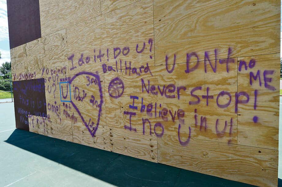 Hour photo / Erik Trautmann the raquet wall at Norwalk High School was vandalized with graffiti Friday night.