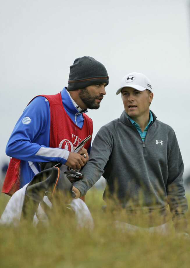 United States' Jordan Spieth, right, speaks with his caddie Michael Greller on the 12th hole during the first round of the British Open Golf Championship at the Old Course, St. Andrews, Scotland, Thursday, July 16, 2015. (AP Photo/David J. Phillip)
