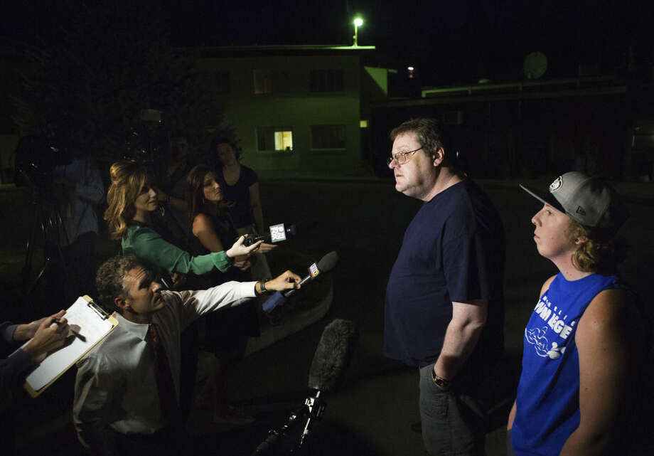 """David Veatch, the father of Autumn Veatch, 16, along with family friend Chelsey Clark, right, speak to the media outside the Three Rivers Hospital in Brewster, Wash. on Monday, July 13, 2015. """"Survivorman should be proud of her,"""" Veatch said. He says Autumn has no training other than watching survival shows with him at home. 16-year-old Autumn had been missing since the plane she and her step-grandparents, Leland and Sharon Bowman, of Marion, Mont., crashed in the North Cascades on Saturday. Veatch, apparently the only survivor of the crash, hiked out of the crash site and managed to hike her way to the Mazama area. (Lindsey Wasson/The Seattle Times via AP)"""