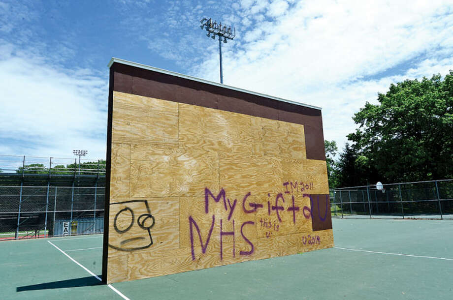 Hour photo / Erik Trautmann the raquet wall at Norwalk High School was vandalized with graffiti Friday night.