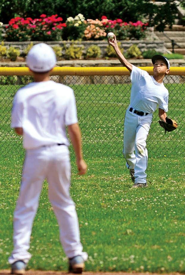 Hour photo / Erik Trautmann Kyle Gordon fields a ball during the Norwalk Little League All-Star team practice at Veteran's Park Saturday.