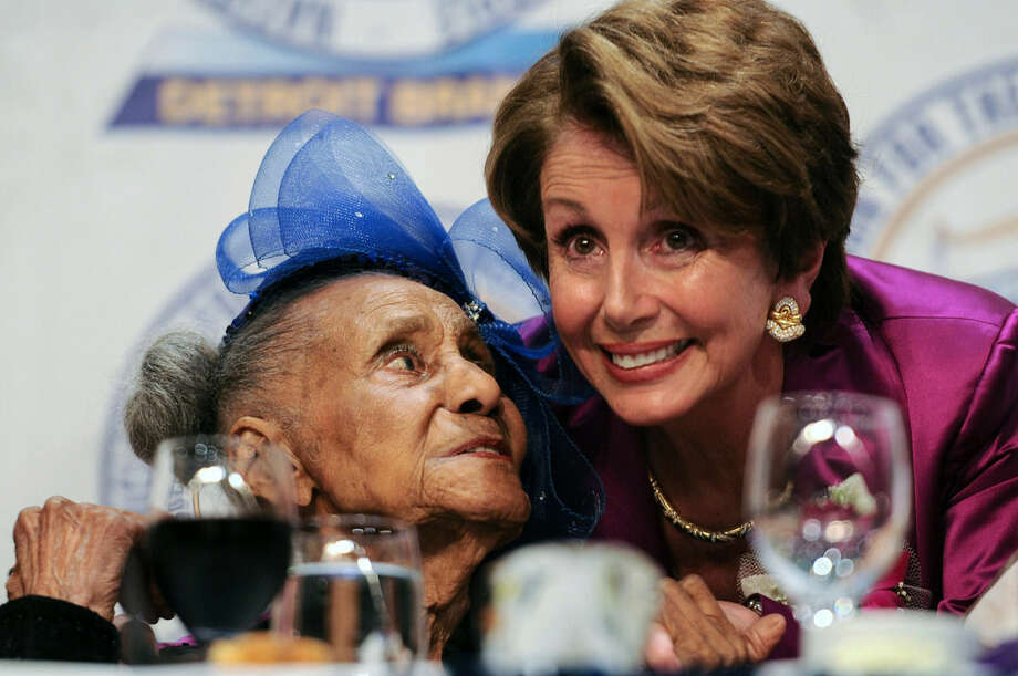 In this photo taken on April 28, 2013, U.S. House Minority Leader Nancy Pelosi, right, hugs 108 year-old Emma Didlake after Didlake was given the James Weldon Johnson lifetime achievement award at Detroit NAACP's 58th annual Freedom Fund Dinner at the Cobo Center in Detroit. Didlake, believed to be the oldest living veteran, is being honored with a trip to Washington, D.C., that includes a scheduled meeting with President Barack Obama and a visit to the memorial of her other favorite president, Franklin D. Roosevelt. (Tanya Moutzalias/The Ann Arbor News/MLive.com via AP) LOCAL TELEVISION OUT; LOCAL INTERNET OUT