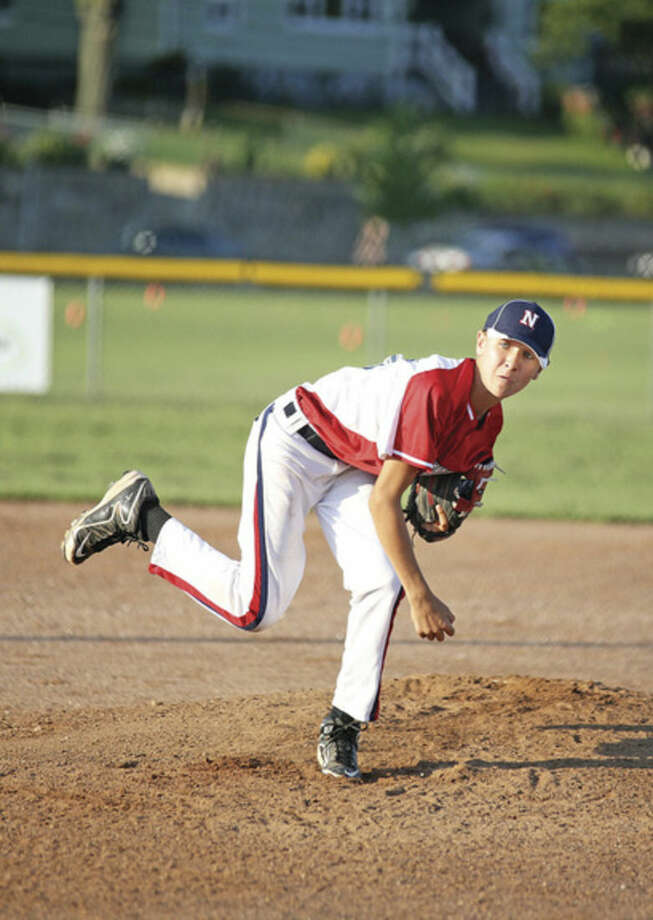 Hour photo/Danielle Calloway Norwalk Little League pitcher Korey Morton lets go of a pitch during Thursday's game against Norwalk Cal Ripken at Veterans' Park. Morton led Little League to a 13-1 victory.