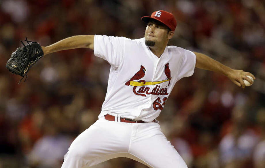 St. Louis Cardinals relief pitcher Nick Greenwood throws in his major league debut during the seventh inning of a baseball game against the New York Mets Monday, June 16, 2014, in St. Louis. (AP Photo/Jeff Roberson)