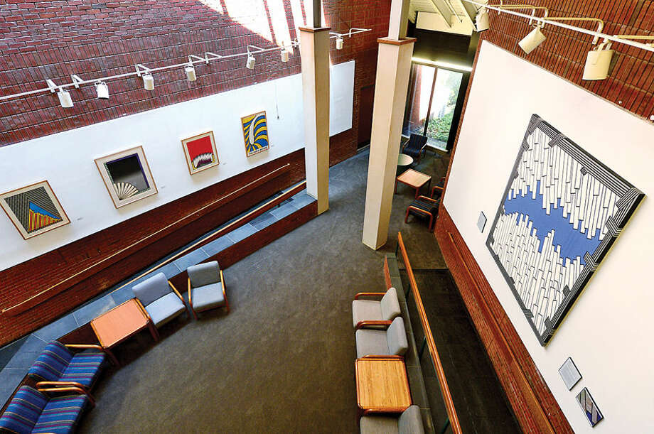 A newly restored Nicholas Krushenick painting, Flypath 1, at right, is being exhibited with other of the artists paints in the East Campus gallery.