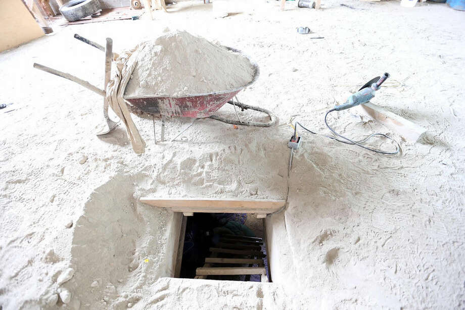 """This photo provided by Mexico's attorney general, shows the exit of the tunnel they claim was used by drug lord Joaquin """"El Chapo"""" Guzman to break out of the Altiplano maximum security prison in Almoloya, west of Mexico City, Sunday, July 12, 2015. A massive manhunt is underway after Guzman, escaped from the maximum security prison through the tunnel that opened into the shower area of his cell, the country's top security official announced. (Mexico's Attorney General's Office via AP)"""