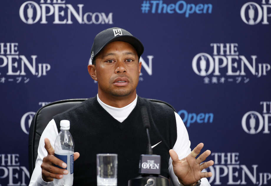 United States' Tiger Woods speaks during a news conference ahead of a practice round at the British Open Golf Championship at the Old Course, St. Andrews, Scotland, Tuesday, July 14, 2015. (AP Photo/Jon Super)