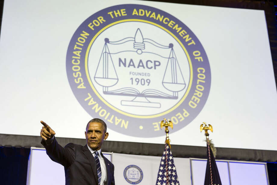 President Barack Obama points as he arrives to give a speech at the NAACP's 106th national convention at the Philadelphia Convention Center, on Tuesday, July 14, 2015, in Philadelphia. (AP Photo/Evan Vucci)