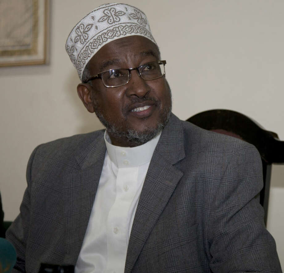 Abdullahi Abdi, Chairman National Muslim Leaders Forum ( NAMLEF), is seen during a press conference in Nairobi, Kenya, Tuesday, June, 17, 2014. Extremists attacked a coastal area of Kenya for the second night in a row, killing at least nine people a day after the deaths of nearly 50, an official said Tuesday. Police spokesman Masoud Mwinyi said that al-Shabab militants attacked Majembeni village. The Somali militant group also claimed responsibility for the Sunday night attack in nearby Mpeketoni that killed 48 people. The Muslim leaders condemned the killings as savage acts and warned that they should not divide Kenyans along religious lines.(AP Photo/Sayyid Azim)