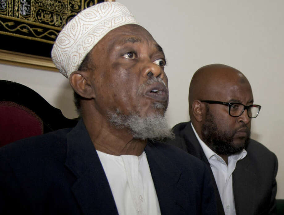 Sheikh Muhammad Khalifa, left, from the Council of Imams and Preachers of Kenya, (CIPK), speaks during a press conference with Ibrahim Ahmed Yusuf, right, of the Jamia Mosque Committee in Nairobi, Kenya, Tuesday, June, 17, 2014. Extremists attacked a coastal area of Kenya for the second night in a row, killing at least nine people a day after the deaths of nearly 50, an official said Tuesday. Police spokesman Masoud Mwinyi said that al-Shabab militants attacked Majembeni village. The Somali militant group also claimed responsibility for the Sunday night attack in nearby Mpeketoni that killed 48 people. The Muslim leaders condemned the killings as savage acts and warned that they should not divide Kenyans along religious lines.(AP Photo/Sayyid Azim)
