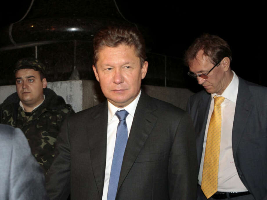 Gazprom CEO Alexei Miller, center, leaves the government building in Kiev, Ukraine, Monday, June 16, 2014. Gazprom has said it needs $1.95 billion from Ukraine's Naftogaz for gas deliveries or it will start demanding payment in advance on Monday. The dispute is part of wider tensions after Russia annexed Ukraine's Crimean Peninsula in March. (AP Photo/Sergei Chuzavkov)