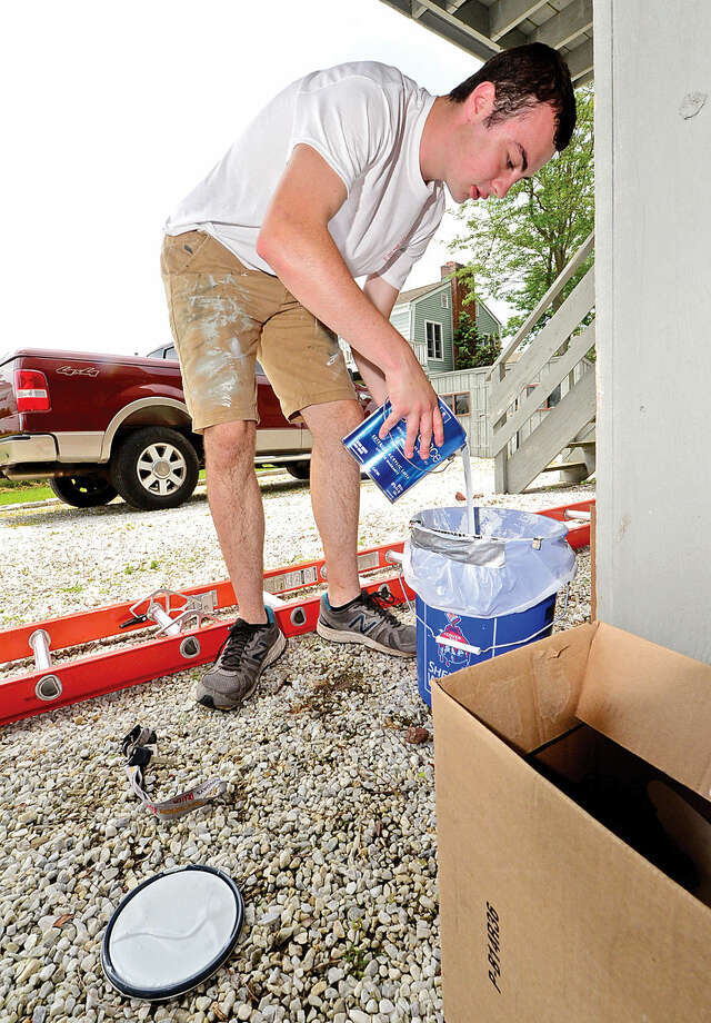 Hour photo / Erik Trautmann Former Norwalk High School student William Hessert runs a crew for Student Painters, an exterior house painting company sponsored by Sherwin Williams that trains young entrepreneurs and gives them real world experience.