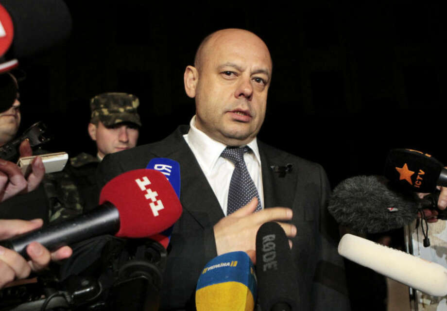 Ukraine Energy Minister Yuriy Prodan to speak to reporters outside the government building in Kiev, Ukraine, Monday, June 16, 2014. A Monday deadline approached with no sign of progress in resolving a months-long dispute over exactly how much Ukraine owes Russia for past natural gas deliveries and what price the nation should pay for future supplies. (AP Photo/Sergei Chuzavkov)