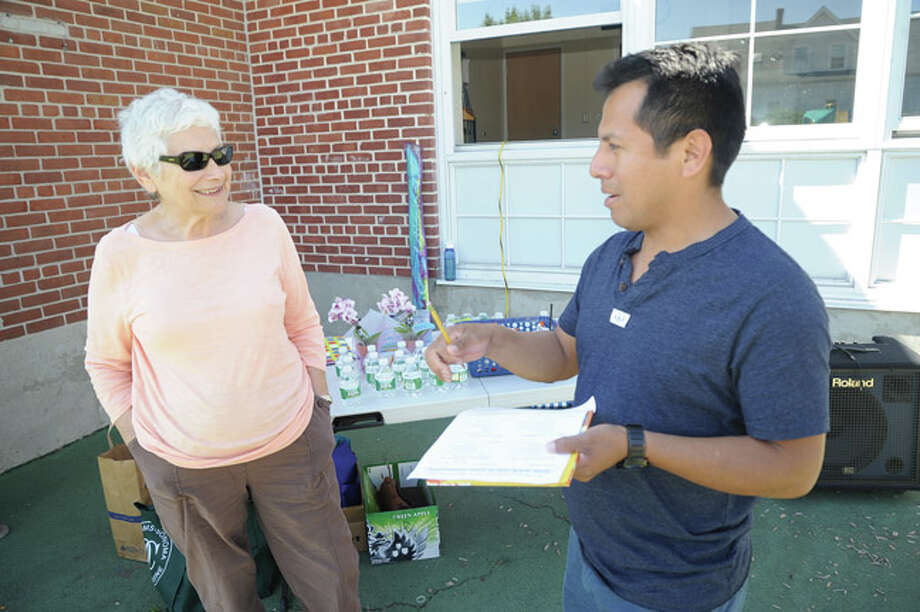 Frieda Knopf and Frankiln Pascual at K.T. Murphy Elementary School in Stamford. Franklin and other parents filled out forms making a checklist of how walkable the area is around the school.