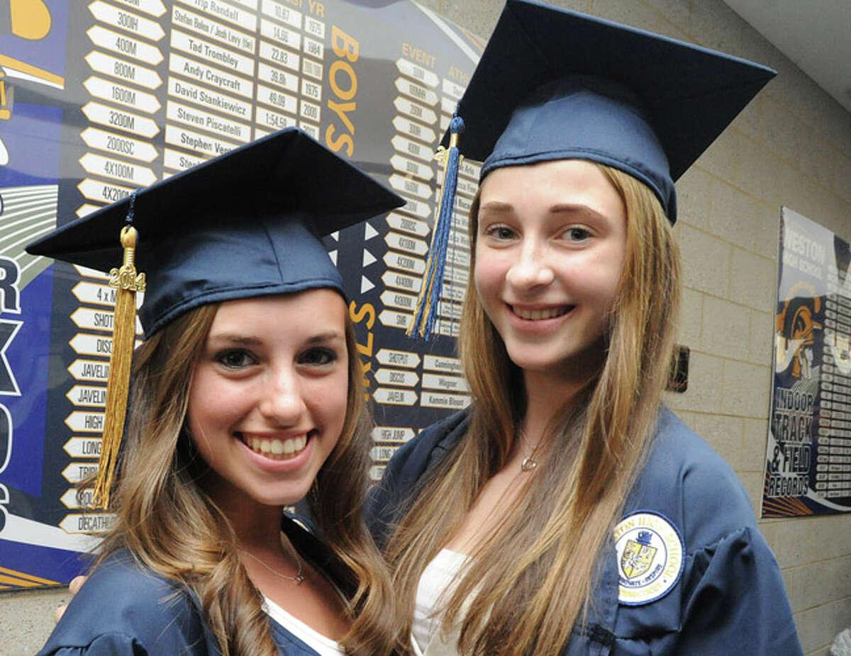 Megan Richardson and Olivia Gautiel at the Weston High School graduation ceremony Tuesday night. Hour photo/Matthew Vinci