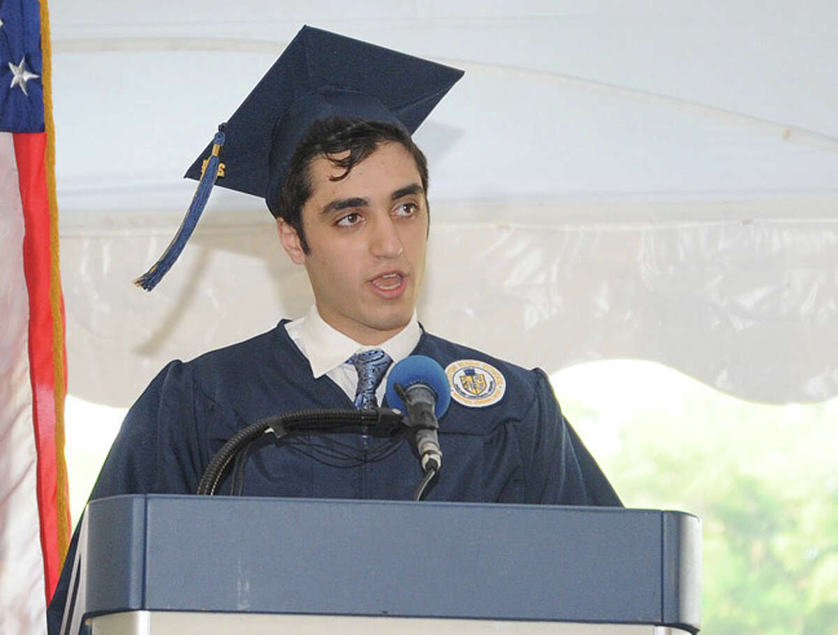 Julian Jacobs gives the student address at the Weston High School graduation ceremony Tuesday night. Hour photo/Matthew Vinci