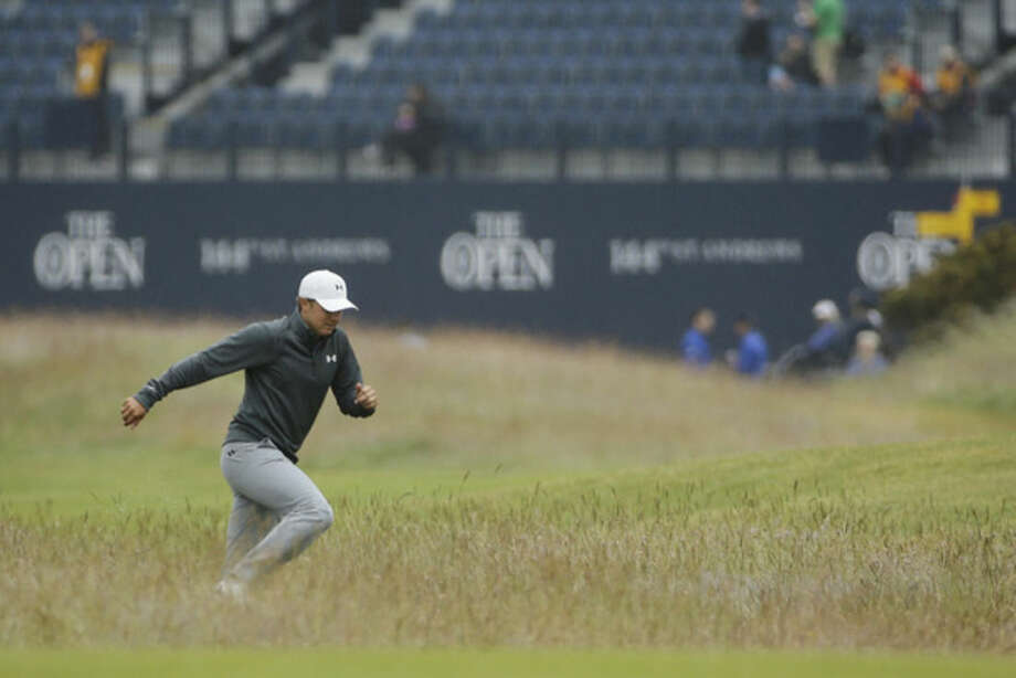 United States' Jordan Spieth runs through the rough to the 17th tee to join his group during a practice round at the British Open Golf Championship at the Old Course, St. Andrews, Scotland, Wednesday, July 15, 2015. (AP Photo/David J. Phillip)