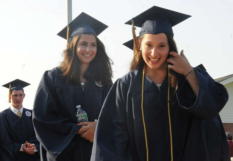 Alexa Herman and Lexia Hero at the Weston High School graduation ceremony Tuesday night. Hour photo/Matthew Vinci