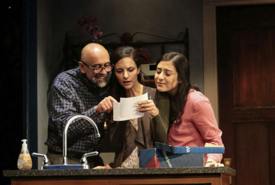 "This undated photo released by Lincoln Center Theater shows, from left, Bernard White, Tala Ashe and Nadine Malouf in a scene from ""The Who & The What,"" a new play by Ayad Akhtar currently performing off-Broadway at LCT3's Claire Tow Theater in New York. (AP Photo/Lincoln Center Theater, Erin Baiano)"