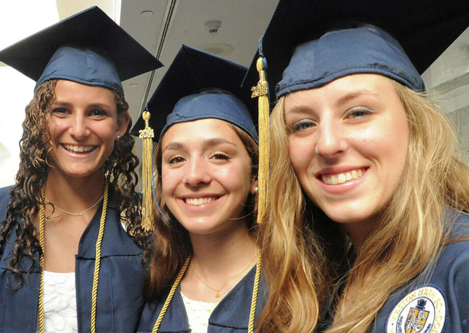 Whitney Farber, Natalie Oakes and Jordan Isaacs at the Weston High School graduation ceremony Tuesday night. Hour photo/Matthew Vinci