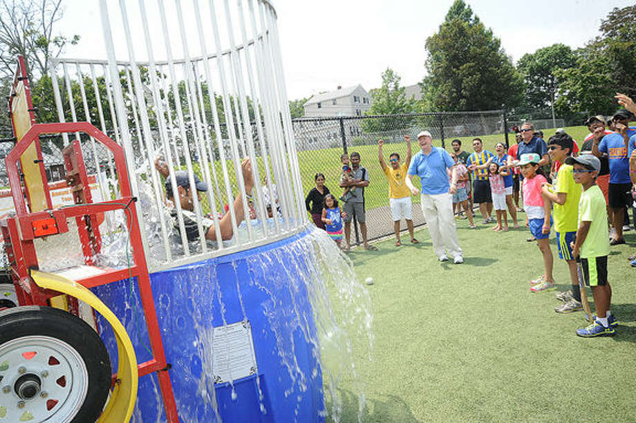 A dunk tank as part of the fun for the fundraiser for Americares by the Stamford Cricket Club. Hour photo/Matthew Vinci