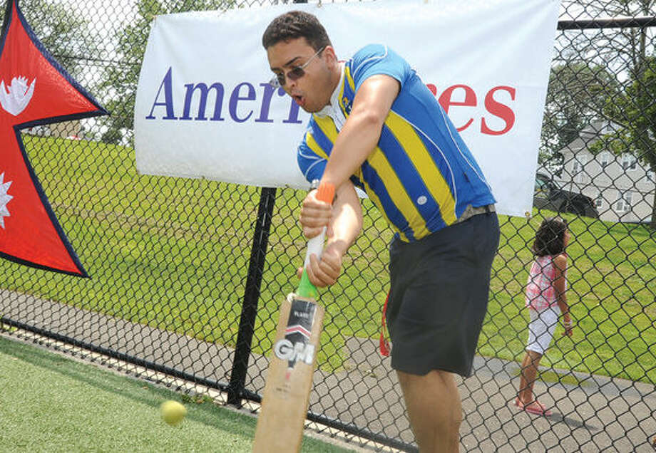 Stamford Cricket Club member Pukar Pudasaini in the game at Lione Park in Stamford where the club raised over $13,000.00 for Americares for thier recent work in Nepal. Hour photo/Matthew Vinci