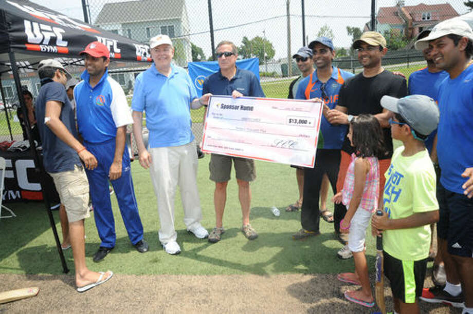 A check for over $13,000.00 for Americares for their recnt work in Nepal from the Stamford Cricket Club. Hour photo/Matthew Vinci