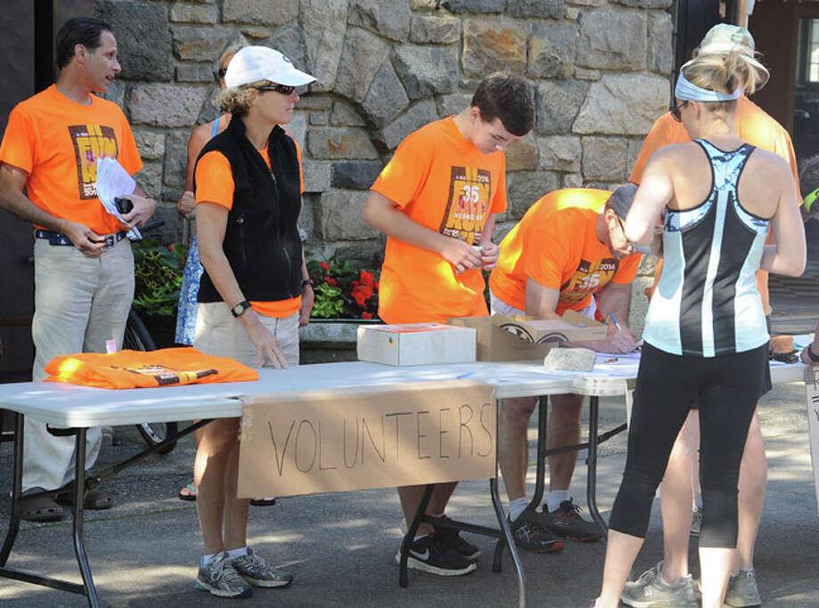 Volunteers sign in runners for the 35th annual Fun Run race in Rowayton. Hour photo/Matthew Vinci