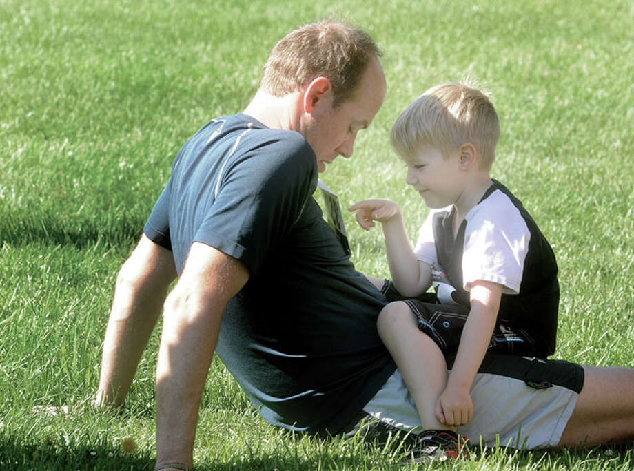 Richard Sellschop and his son Oliver 5, enjoy a moment together at the Rowayton Community Center Sunday before the annual Fun Run Race. Hour photo/Matthew Vinci