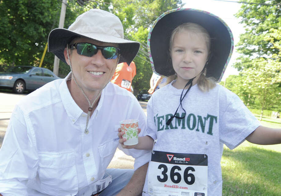 Andy Hicks and his daughter Catherine 6, get ready for the Fun Run race Sunday in Rowayton. Hour photo/Matthew Vinci